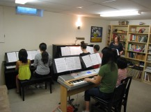 Rehearsal for 101 Pianists